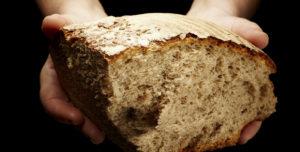 Startsida bröd i händer